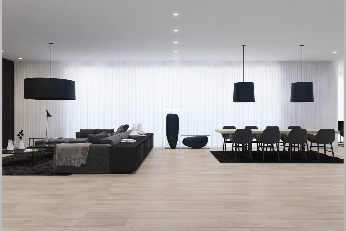 Cylindrical elements gain greater importance as the space progresses. Hanging lights and standing ornaments give character and attract the eye. Wood takes the form of chairs and kitchen cabinets, while a slate bench adds difference.