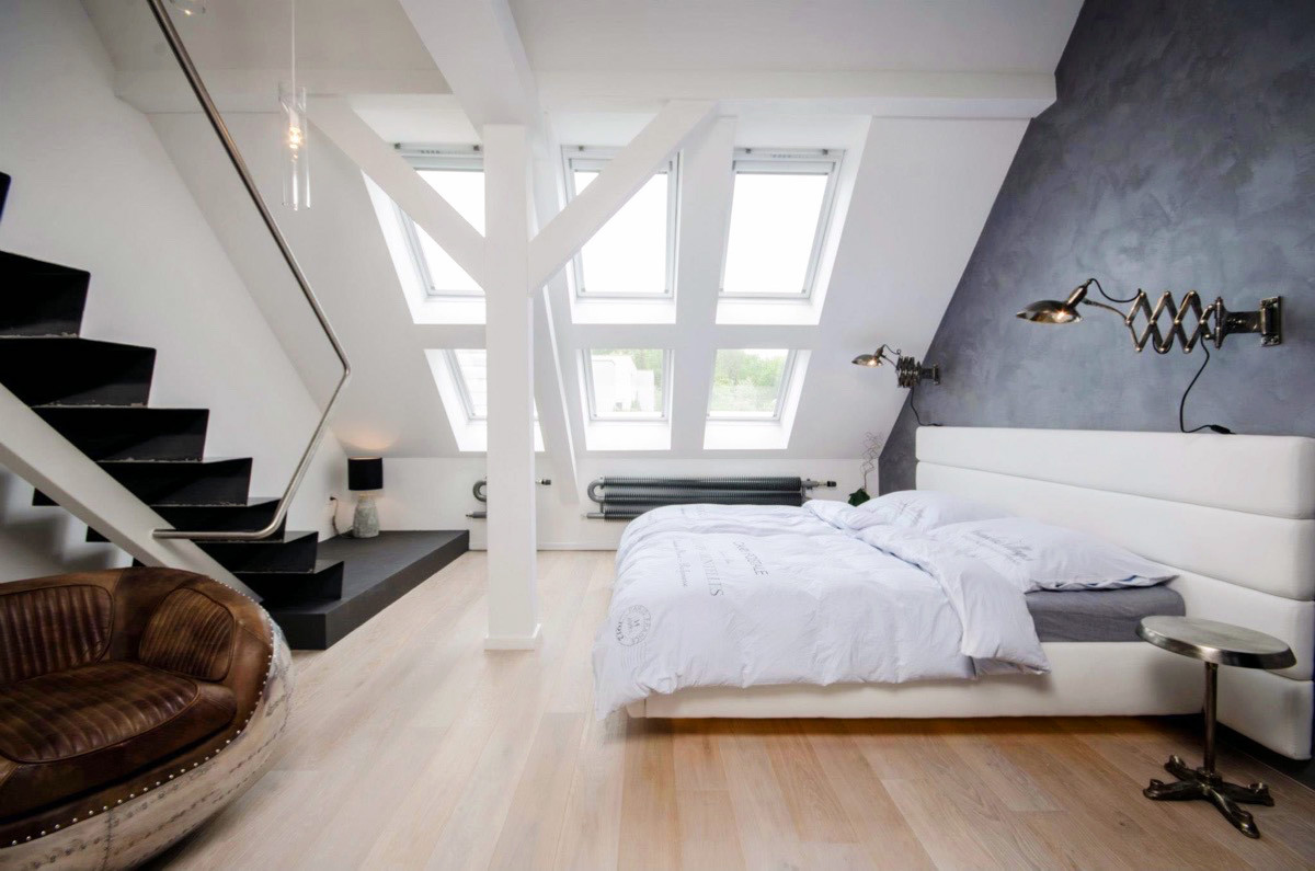 Black Staircase Attic Bedroom White Headboard Brown Chair - 25 amazing attic bedrooms that you would absolutely enjoy sleeping in