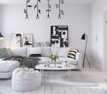 This cottage-inspired Scandinavian home includes traditional elements next to sleek modern influences. Distressed wood floors immediately set the scene as a chic and casual style, with patterned pillows to up the sense of playfulness. On the other hand, the typographic decor and bold contemporary lighting bring the entire interior back up-to-date.