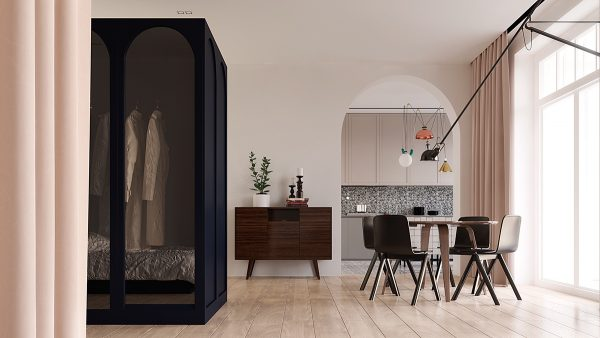 Although the living room and bedroom are paired together much like a studio the kitchen enjoys its own space accessible through a dramatic arched doorway