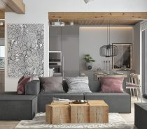 Your eye immediately is drawn to the fun line art hanging on the wall in this loft-like living room.