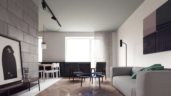 The apartment follows a layout in the shape of a u with the living room transitioning to the dining room and kitchen around a simple bend