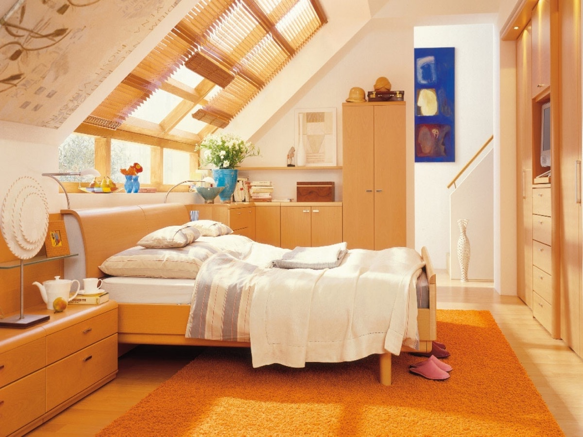 Orange Attic Bedroom Blue Artwork Built In Storage - 25 amazing attic bedrooms that you would absolutely enjoy sleeping in