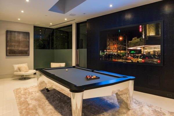 ... This Home Has Plenty Of Spaces Dedicated To Having A Good Time. This  Billiards Room Is Modern. There Is A High Pile Rug Under The Pool Table And  ...