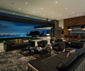 Wouldn't you love sitting on one these black couches and drinking champagne while looking over the city? The owners of this home get to do just that every day of their lives! This home has sweeping views of the twinkly lights at night.