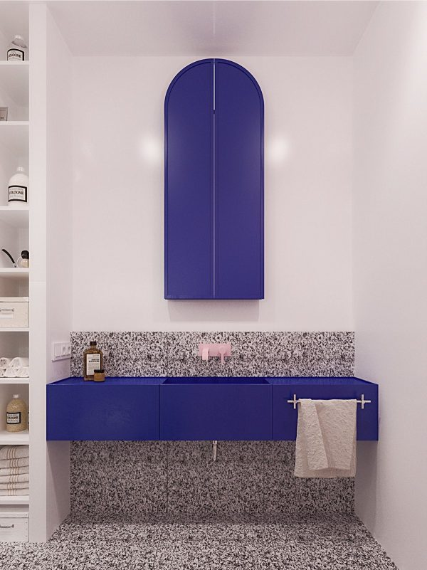 The bathroom is perhaps the boldest room of all composite tiles a light pink faucet and vivid blue cabinetry feel vintage and contemporary all at once