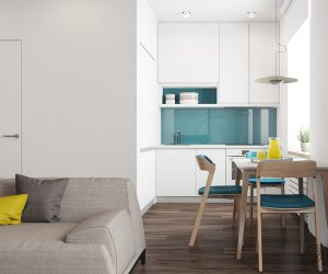 A peek around the corner of this tiny apartment reveals a cute kitchen. The teal backsplash matches the inside of the living room office. The small dinette chairs also match.