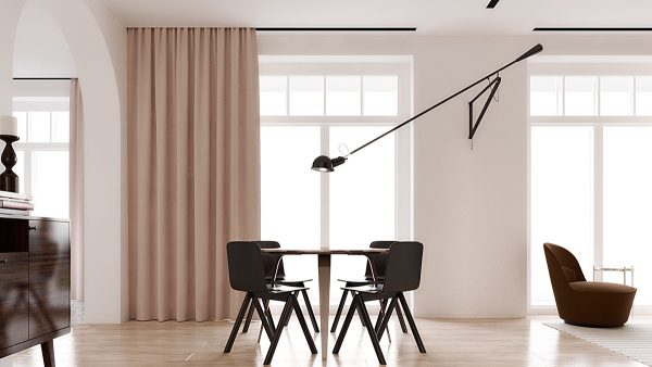 Rather than relying on conventional pendant lighting for the dining area this interior takes a different approach with a swiveling wall mounted lamp by