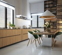 This natural wood wine storage wall is the highlight of the dining room. The same material is used with the cabinets in the kitchen to bring it all together. Spotlights make it front-and-center.