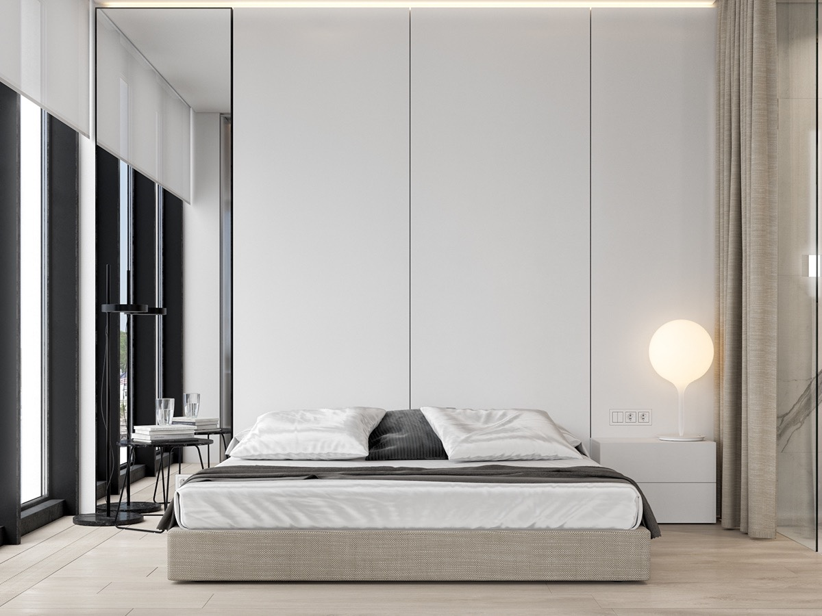 More masculine bedrooms can create calm in colour contrast. Using white, high panelling and an idea-balloon side light, black and grey stripe the room in simple furnishings.