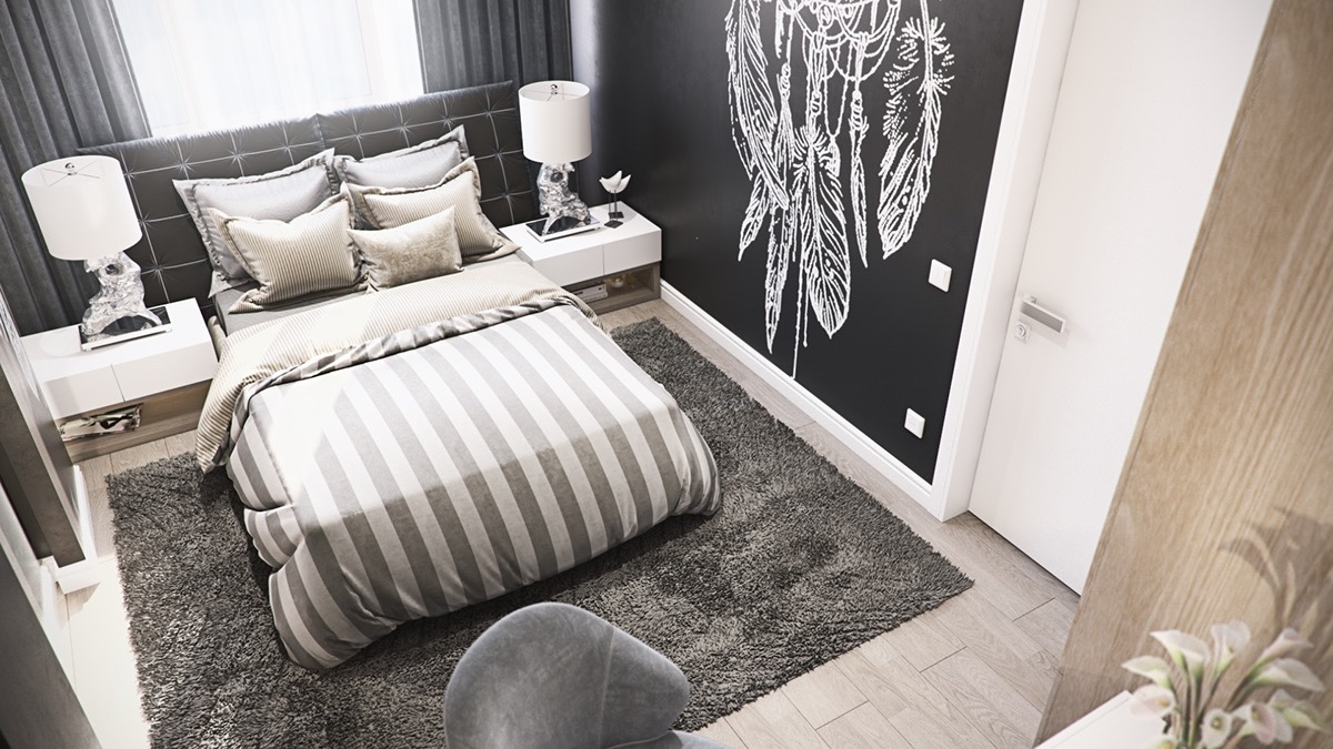 The spare bedroom alternates textures in a surprisingly understated way. Luxurious shagpile rugs and velvet headboards meet the visitor's eye, as a playful chalkboard feature wall and thick-striped bedding proffers discerning patterns.