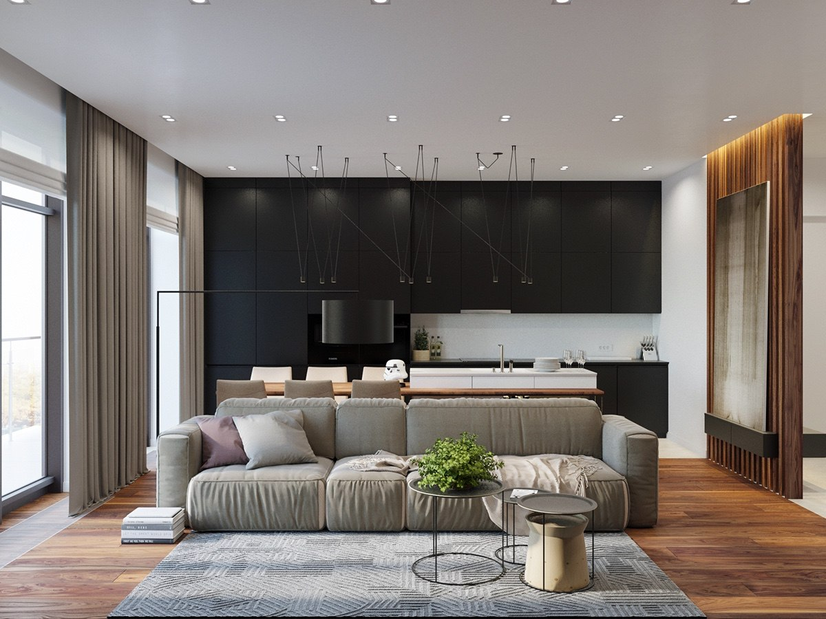 A full-length wooden floor first greets the visitor in the lounge, matched by wooden feature and slatted partition walls. High, stone-coloured curtains add light with a great view, while extensive black cabinetry gives the space a modern feel. Magnetic black hanging lights add eccentricity.