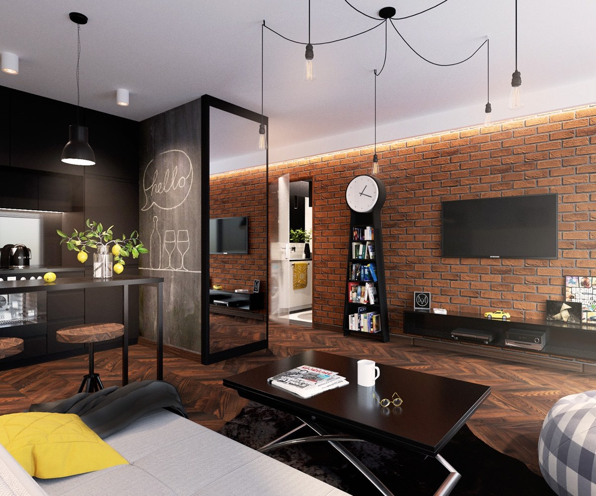 The kitchen offers a place to create words, on a chalkboard wall. Exposed brick holds bold black features in a modern grandfather clock, TV and shelving. An almost-black kitchen ties in the same wood patterning as the floor.