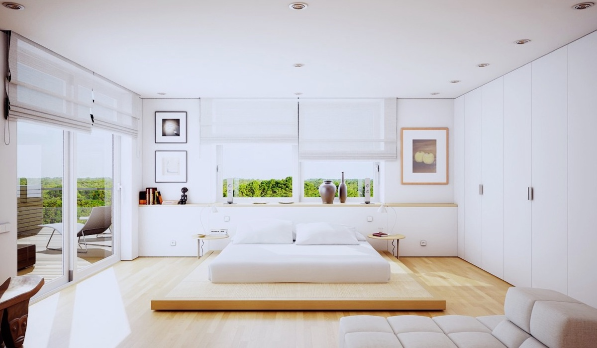 A Japanese-style bedroom is a well-known way to imitate simplicity. A futon-style bed and chaise longue take centre stage in this white-walled and wooden-floored space.