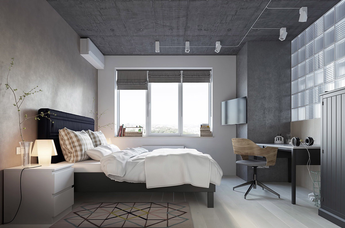 Inhabiting the other side of the living room's glass partition, the bedroom is darker again, a perfect climate for sleeping. Triangle and diamond shapes cover the rug, while a wooden geometric chair, a series of rectangular windows and differing textures fill the corners.