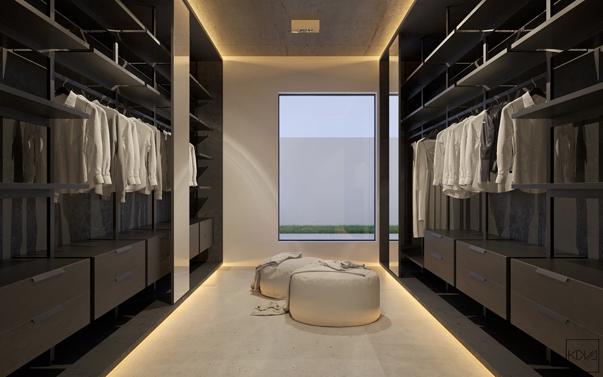 Smaller spaces work even better. A walk-in wardrobe lined with black shelving houses a white ottoman. High granite walls in the bathroom mean a calm backdrop for illuminated wood-panelling, minimalistic yet outstanding. White porcelain fixtures and wooden walls make way.