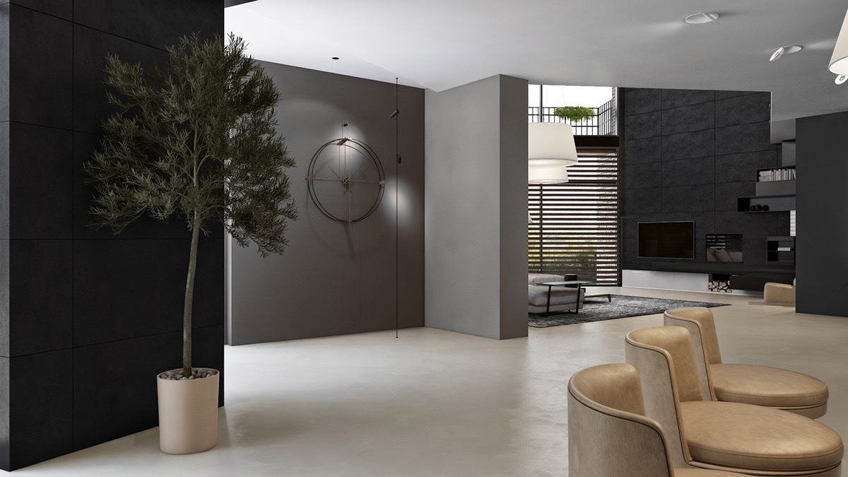 Entering to a multitude of muted shades, a mid-grey wall draws the eye with a sophisticated stencil clock. A touch of life in a potted tree shakes hands with worn beige chairs, which line the entrance and guide visitors through.