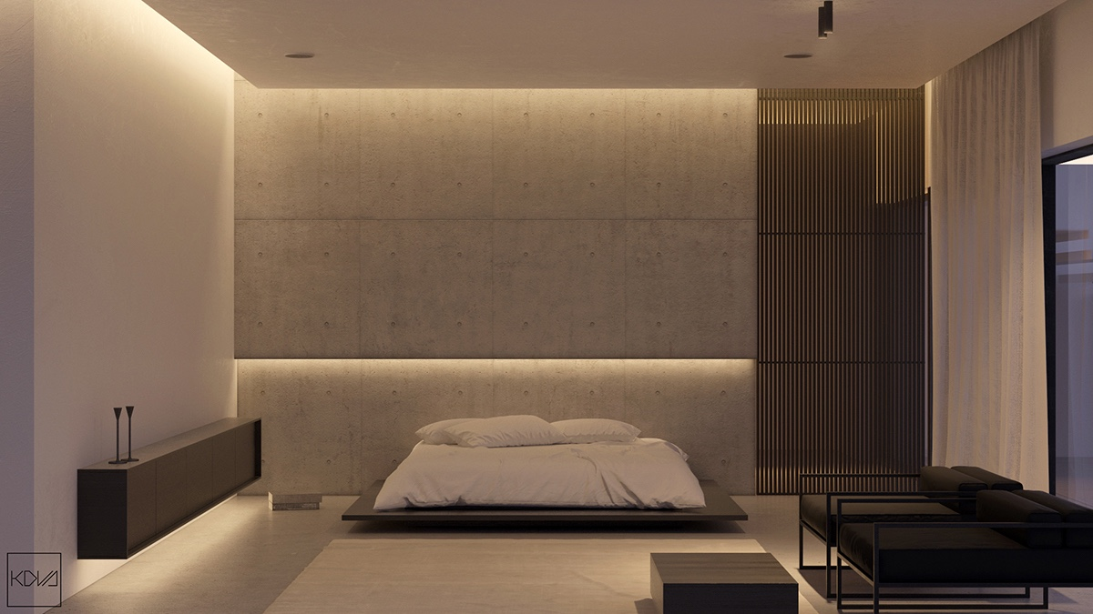 Monochromatic tones result in a Japanese-style minimalism, with a low-lying, futon-style bedroom. Chaise lounges lie close to the floor in black frames, while oblong cabinetry sidles along white walls, gently illuminated.