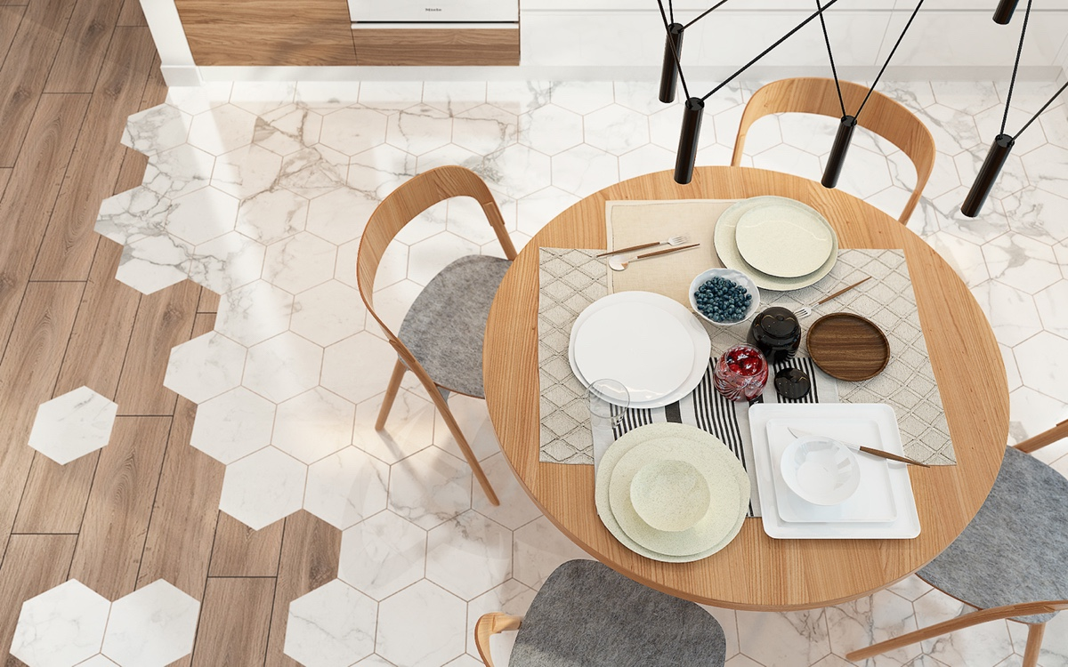 A view to the tile-wooden floor shows personality in a restricted space. Wooden elements reflect themselves in stove housing and wooden chairs, while beige kitchen tiles break the mould.