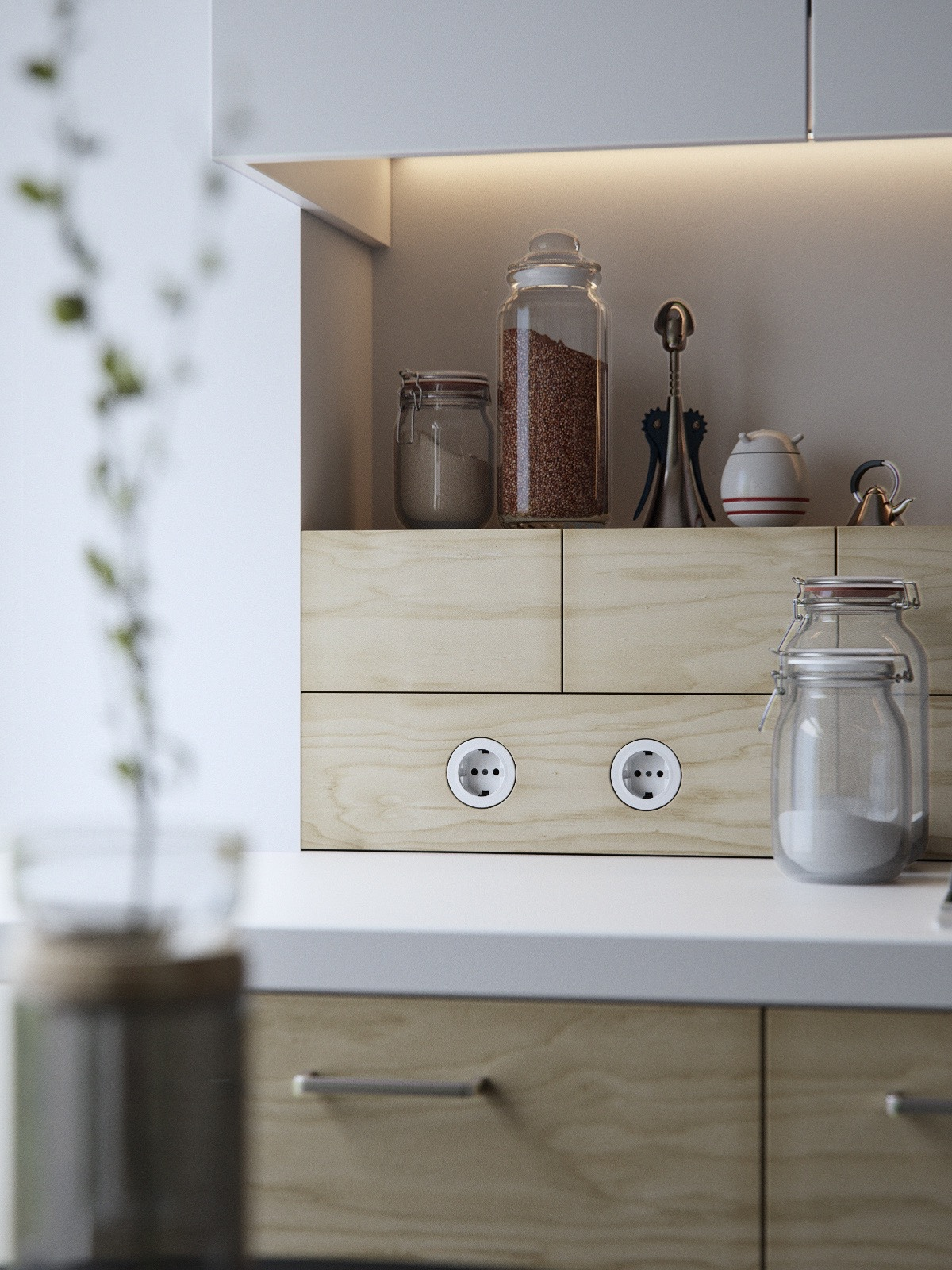 Finer details polish up a space just as much as a grandiose staircase. In the kitchen, simple mason jars reduce clutter.