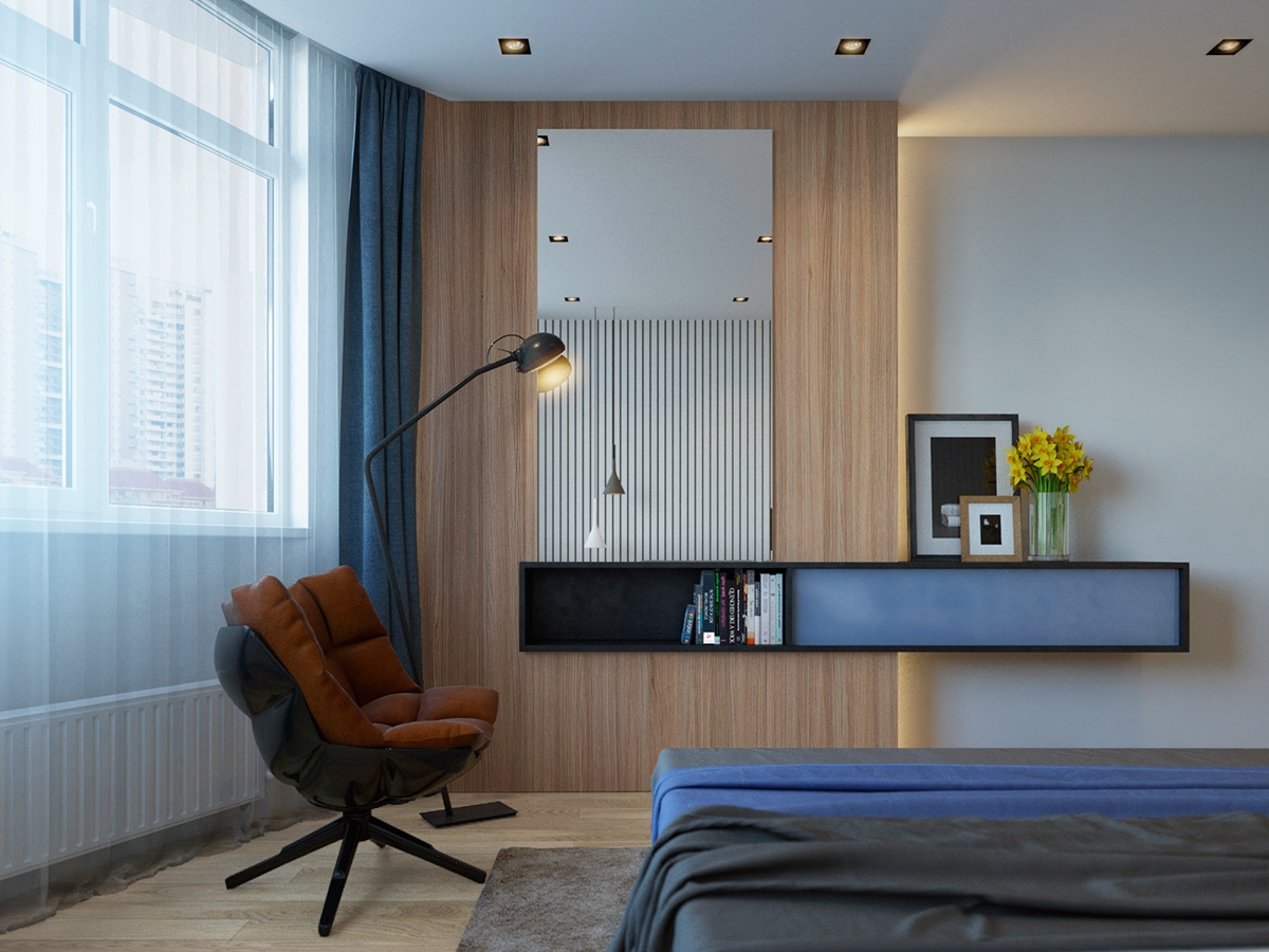 midnight-hued-bedroom-midnight-blue-duvet-dark-terracotta-feature-chair