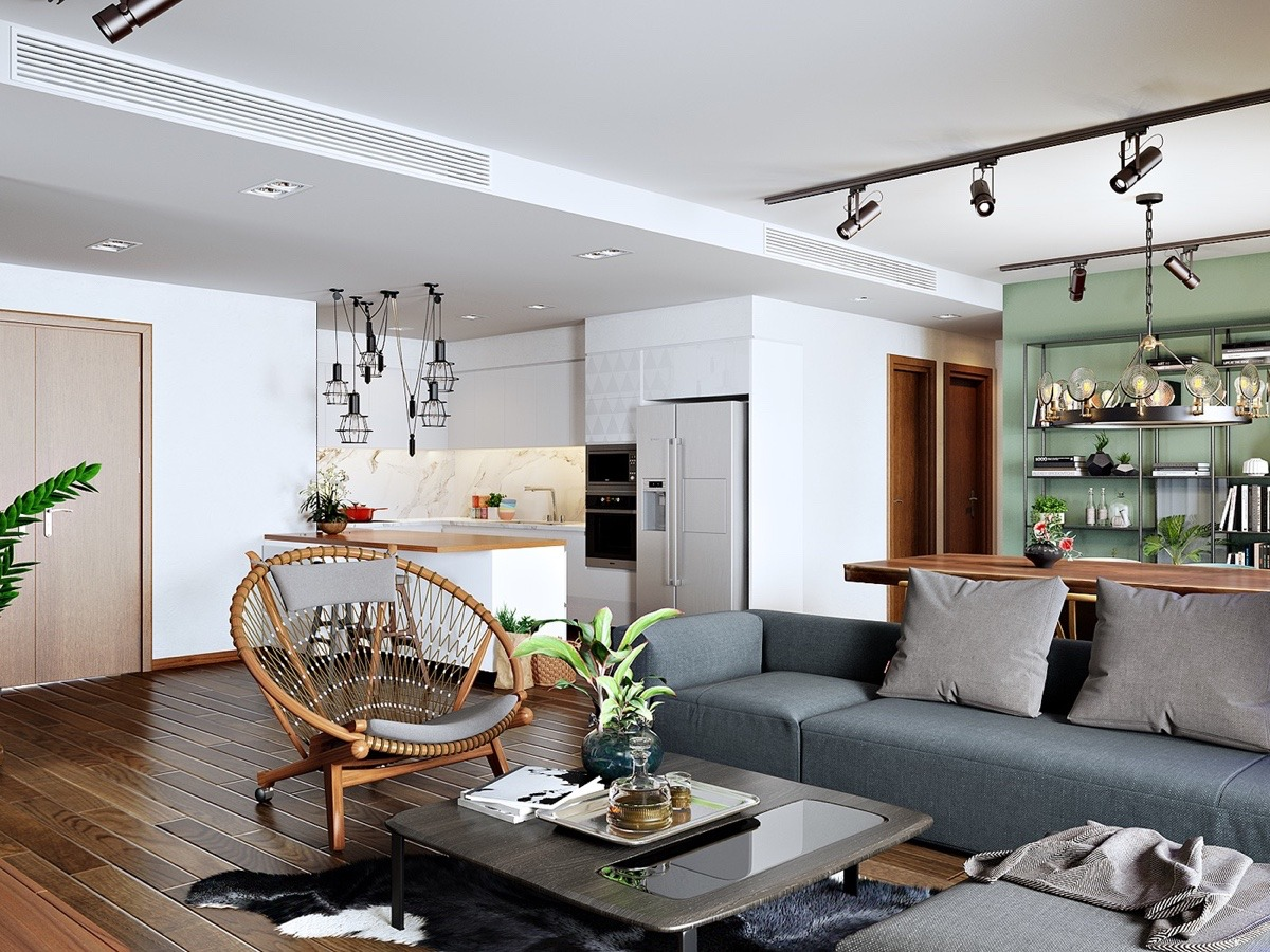 A proliferation of interesting lights guide the space. In the kitchen, hanging metal lights dangle at different lengths, while the dining room hosts the chandelier. Wall-mounted camera lights stay suspiciously on the ceiling, matching the metal bookcase. Met with natural light from the sliding doors, the space affords a lighter view while letting fixtures have their say.