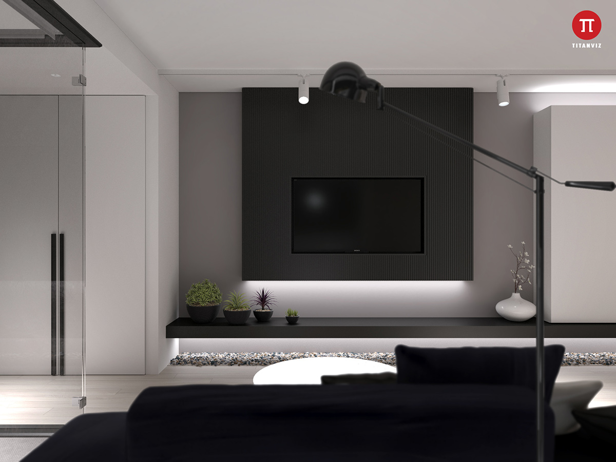 Our last apartment, a small apartment for a young couple, is bolder with its choices in contouring. Here, the living room divides from the bedroom by black framed boxes, contemporary and unusual. Broad TV panels sit on colossal white walls, while black stencils separate plush navy and grey upholsteries. Small touches of potted green and pebbled areas introduce nature.