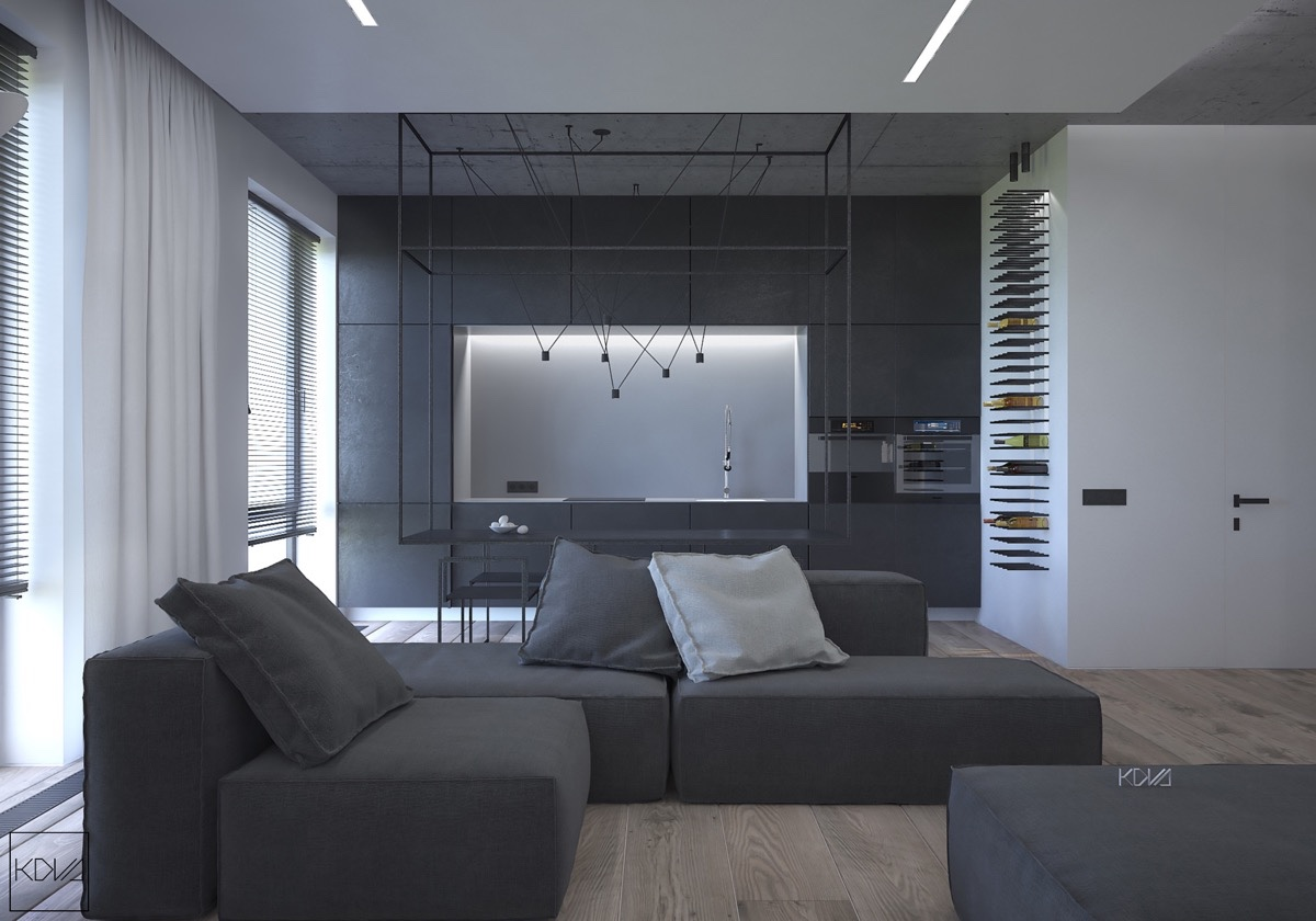 A three-roomed flat in Moscow, Russia, takes a different slant on the same theme. Spanning a much smaller 84sqm, its design is pared back to almost the skeleton of the building, a skeleton sensual, pure and natural. The living, dining and kitchen area show this, with a dynamic hanging dining table acting as focal point. Artistic, magnetic-style hanging lights pair with its form, as soft grey couches, cabinetry, and stencilled dining chairs soften the impact against curtains in white.