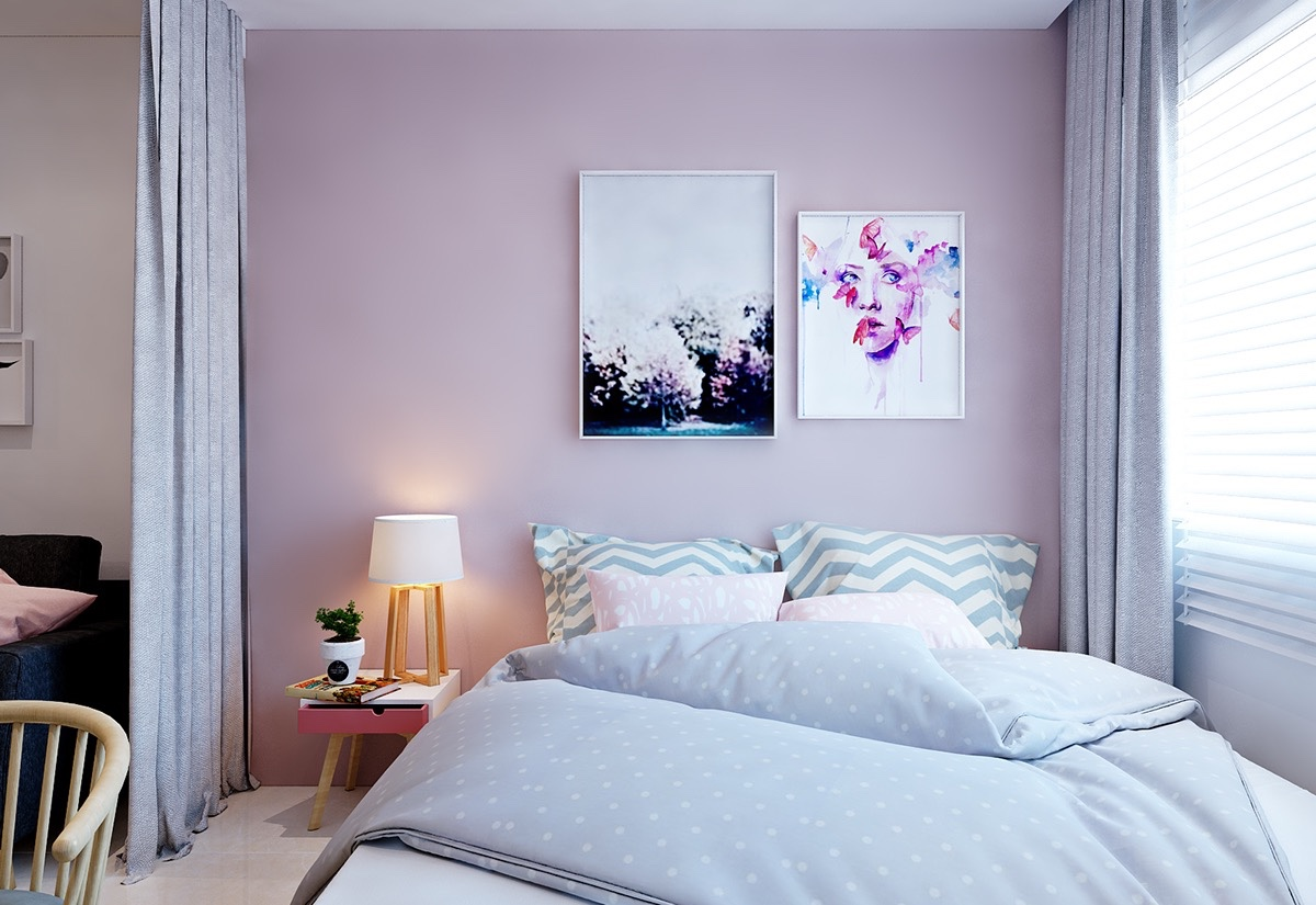 Softer hues clothe the bedroom in pink and light blue, relaxing colours for dreamtime. Abstract prints framed by dividing curtains let the space come into its own, while clothes hide behind white-panelled wardrobe doors.