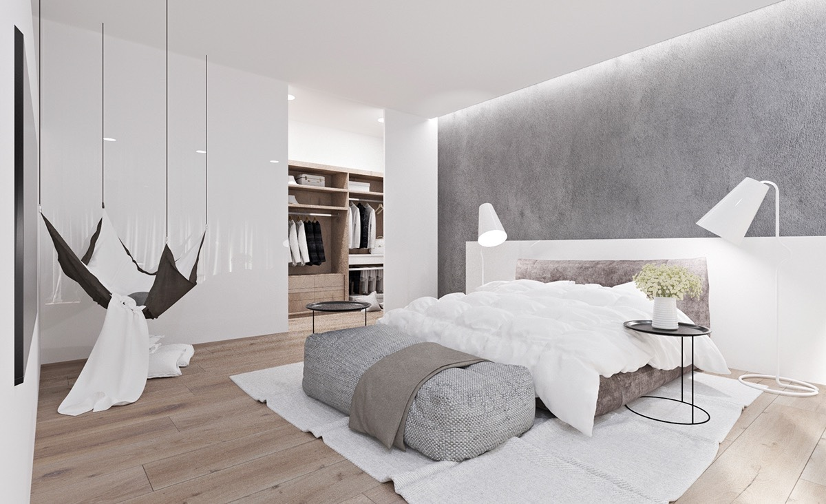 Relaxed upon relaxed is the mantra of this bedroom, grey and white and brown in colour. A hanging hammock and unstructured ottoman invite a simple falling down into plush, dreamy cushions.