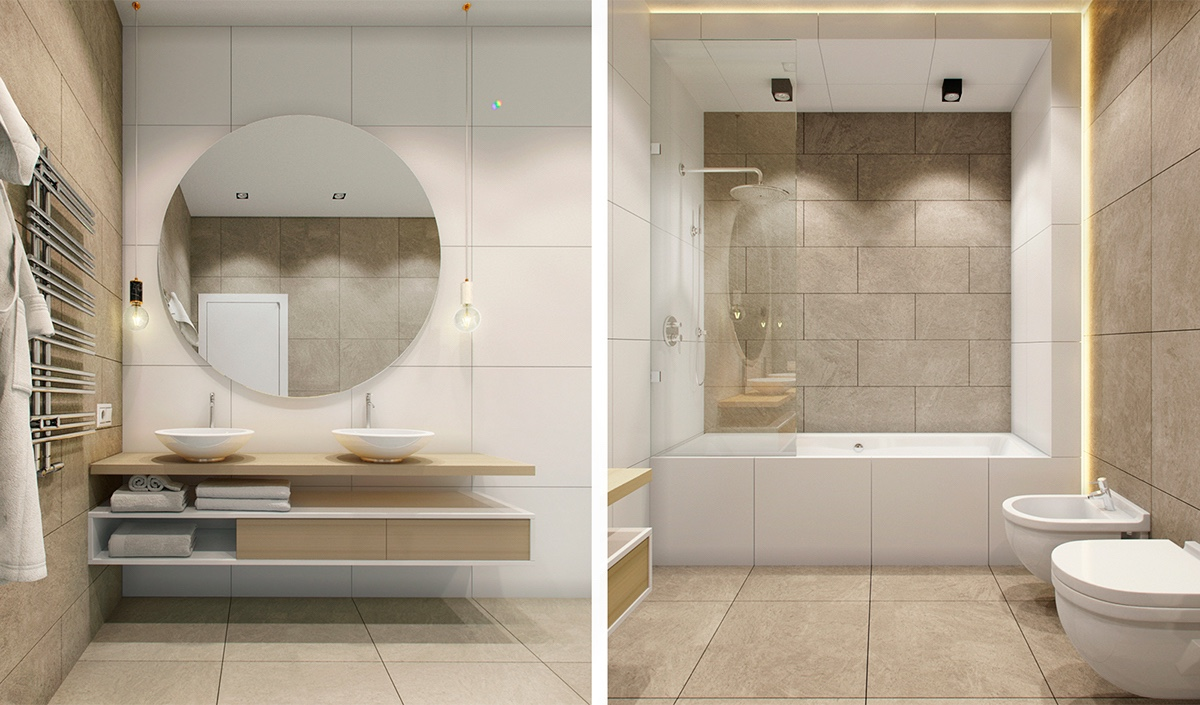 A zen-like bathroom uses minimalist materials to create a feeling of calm for the whole family. A large round feature mirror reflects the wall behind, giving the impression of more space while adding a central focus. Beige and white elements intersect each other in the shelving underneath, and the layout of the simplistic shower.