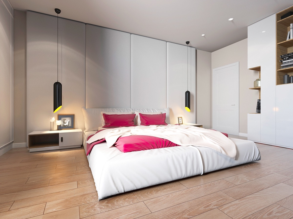 Bright colours can also make features pop in a room, amidst simpler background tones. White walls and light wooden floors in this bedroom hero distinctive cylindrical hanging lights and shocking pink bedding.