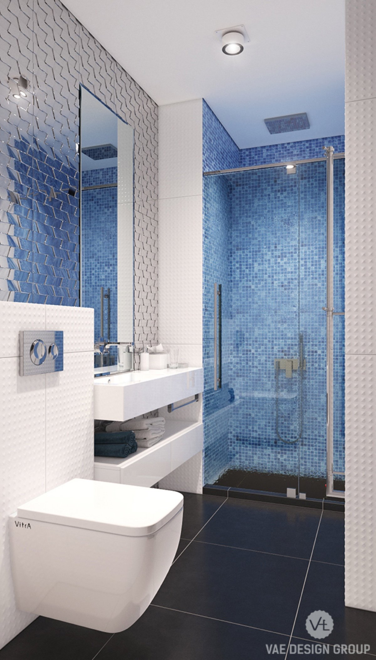 The family bathroom harks to the marine in an understated way. Metallic silver panelling behind the mirror extends it, reminiscent of fish scales. Electric blue tiling says swim, and textured white tiling ties it all together.