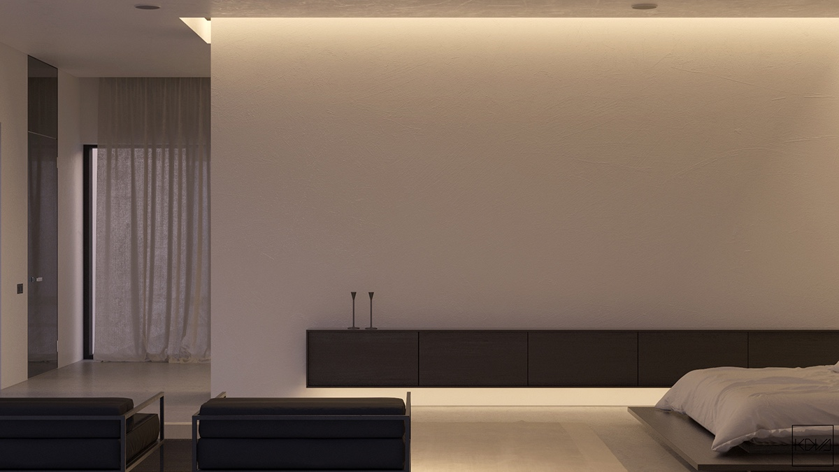 sleek-black-cabinetry-long-rectangular-shaped-couch-bedroom