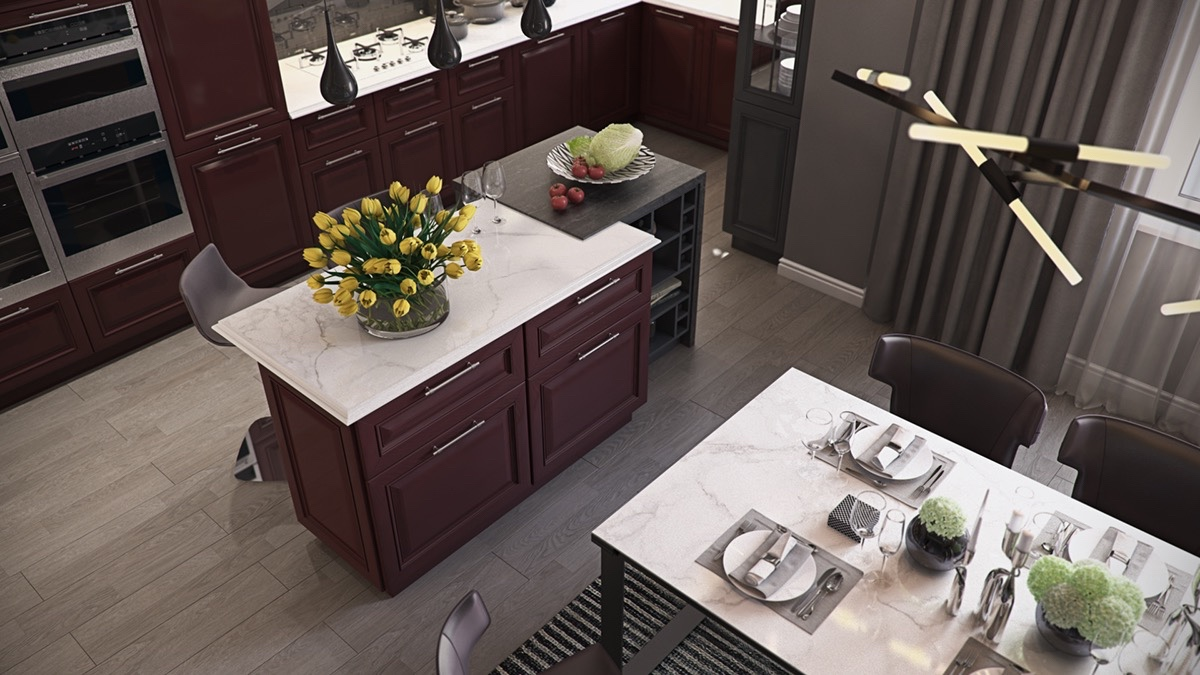 Dining occurs afront backdrops of French-windowed cabinets, under another set of abstract lighting. Settling on a lined rug of wool, leather chairs lift the visitor to elevated tastebuds, while the moveable kitchen island accommodates more space.