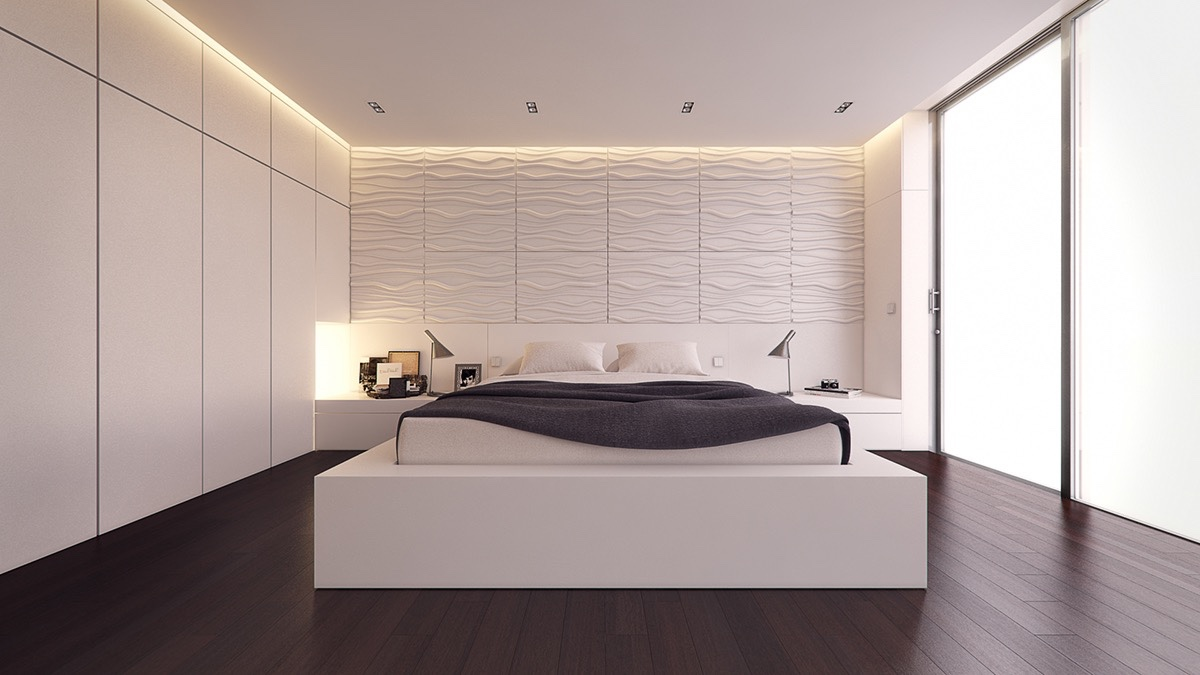 Even simpler textures can take a bedroom to super-standard. A wave-textured wall draws the eye in this space, while a dark wooden floor and charcoal duvet ground the design.