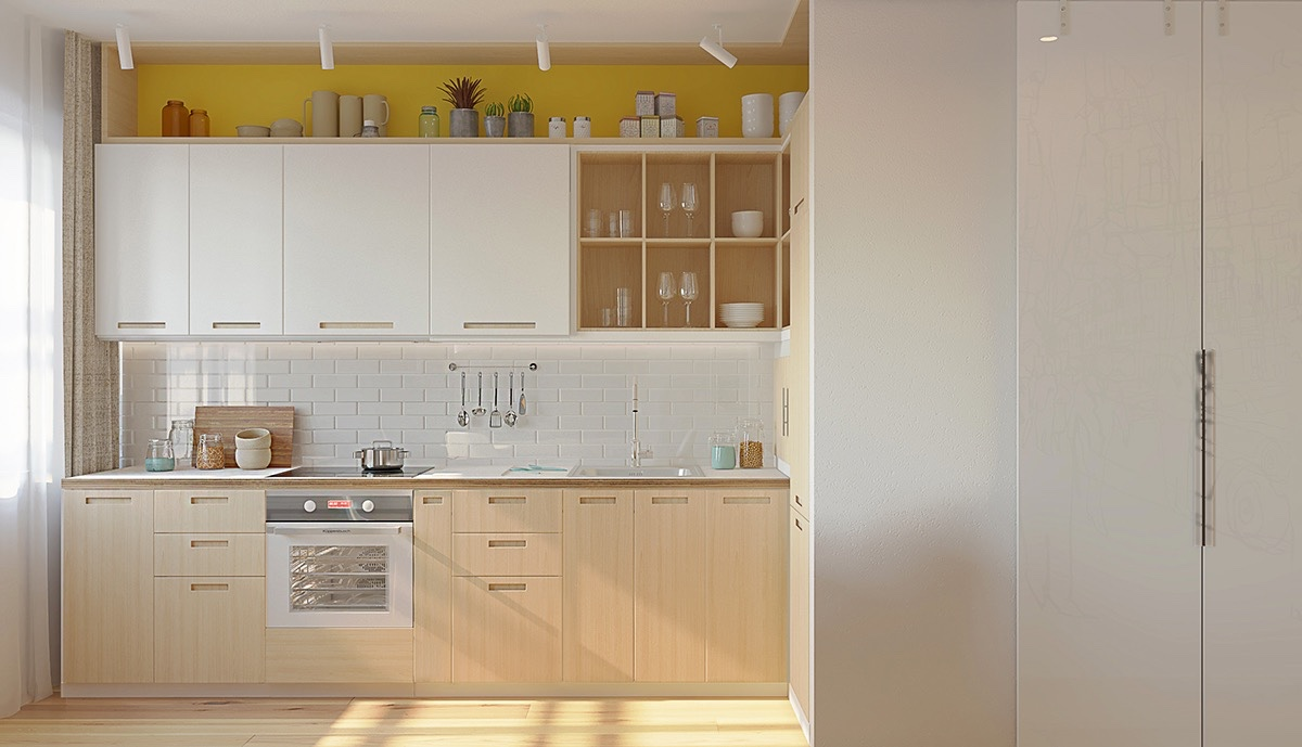 A straight view of the kitchen offers a shifting gaze. The first option points to mustard cupboards, with subtle white tiling and lightwood groundings. Option number two uses white tiling as the feature, illuminating its sheen while white cabinetry fades into the background.