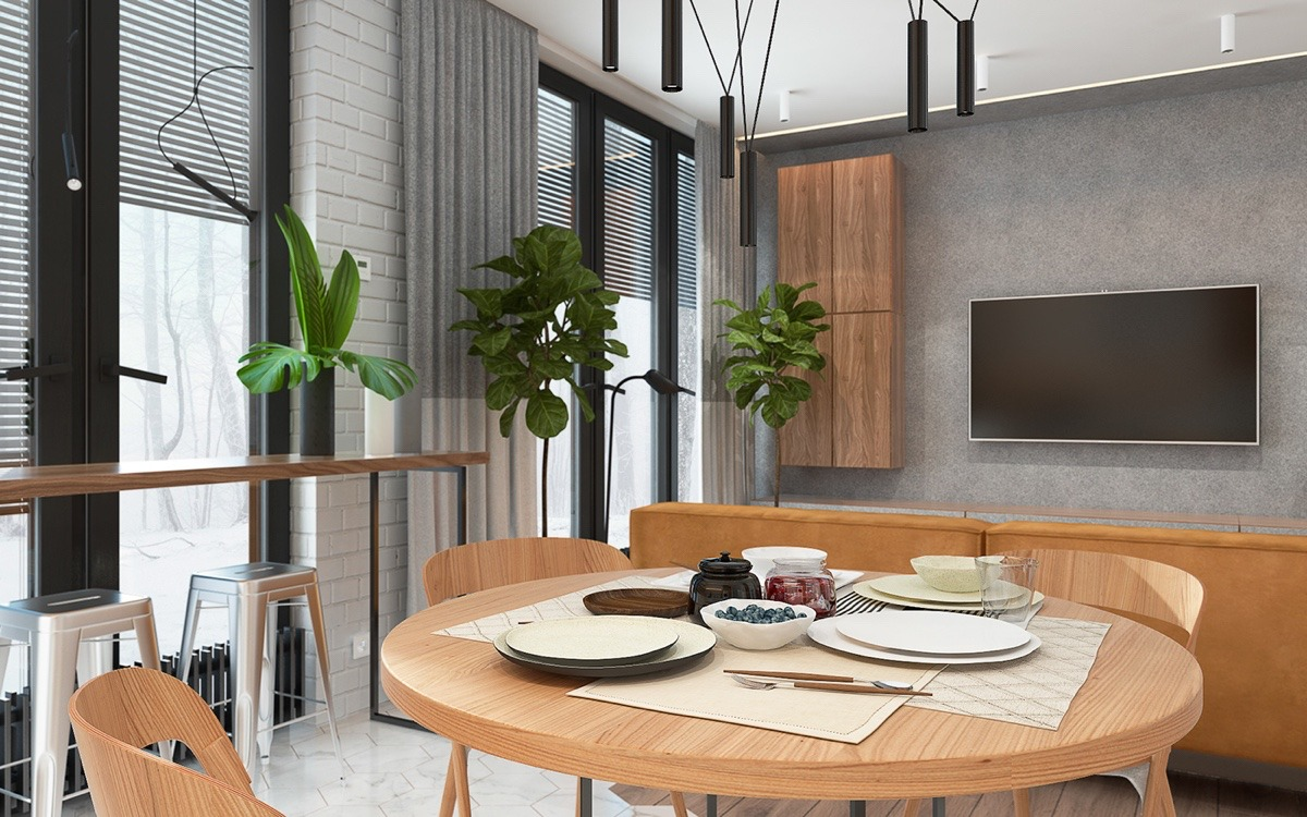 Circular elements in the dining table and plant leaves mirror each other, in a space more resort than inner-city apartment. Rectangular hovering benches and wall panels allow the mounted TV to blend in on earthen-coloured walls.