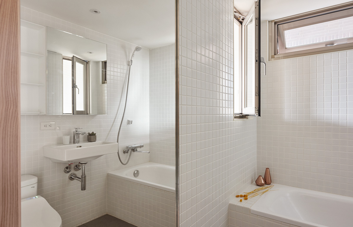 Bright White Tiled Bathroom - 2 super tiny home designs under 30 square meters includes floor plans