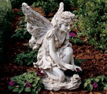 Toscano Fiona, the Flower Fairy Sculpture: Toscano Fiona has an almost magical presence, as she reaches down to tend the flowers she governs. Nestle her amongst a low-lying floral setting so her white wings can pop over flower heads.