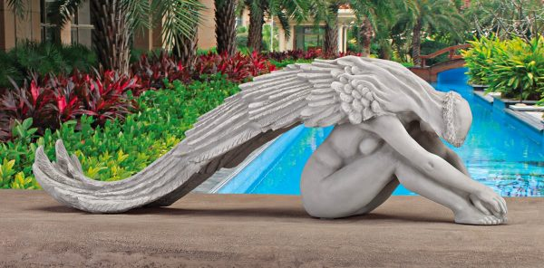 Extended Grace Angel Statue: Adorned with an elongated set of angel wings, this resting angel creates space and tranquillity wherever she goes. Place her on a long, flat surface outside, preferably around flora and fauna, to give her the space she needs.