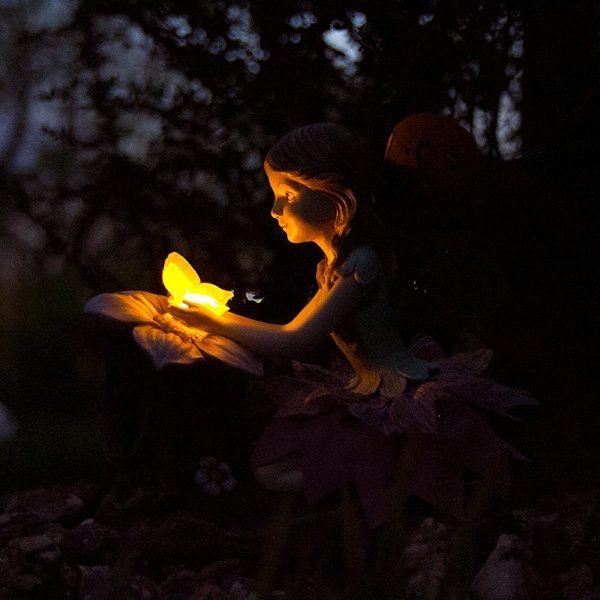 Garden Fairy With Automatic Solar LED Light: Light up your garden with this crouching fairy holding a light. Nestle her amongst low-lying shrubs to guide her light where it is needed.