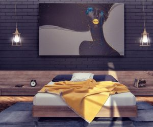 "The designer dubbed this apartment ""Hello-Yellow"" and this beautiful bedroom gives a good example of the name's intent. Artwork, accent wall, and even the floors are dark, lending even more drama and pop to the soft yellow accents like the lips on the painting and the dandelion gold throw blanket on the bed. The painting, of course, brings the distinctive color theme together flawlessly – its colorful details much more vivid than the textile palette it mimics. To balance out the room's surreal style, straightforward industrial lighting and furniture remain relics of the world outside."