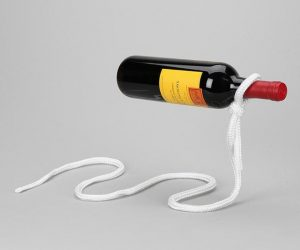 "Lasso Wine Holder: Perhaps even more unexpected is to see a piece of ""ordinary"" string supporting a cantilever wine bottle with little effort. This optical illusion is so realistic, it's bound to become a conversation starter."