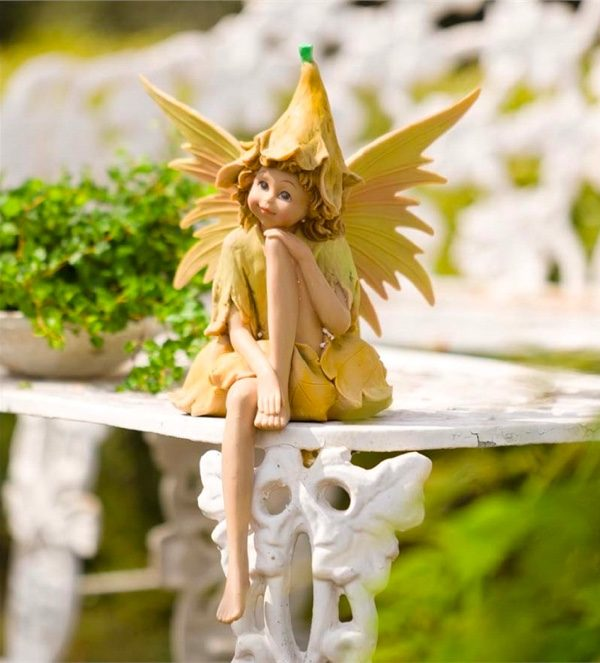 Colorful Sitting Fairy Statue: Fairies are both cheeky and mysterious. Let the sun in with this sitting fairy statue for your garden table.
