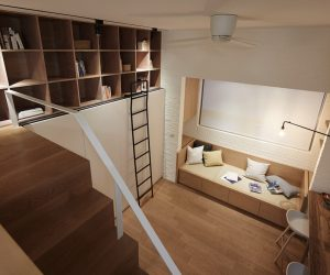Located in Taipei, Taiwan, this apartment simplifies its interior to the most basic elements in order to stretch its 22 square meter layout. The ceilings reach 3.3 meters in height – somewhat low compared to other interiors with mezzanine levels but more than enough for this designer to work with. The resident (a frequent traveler) required ample storage for clothes and books along with wide-open space for exercise, which the designers accommodated without sacrificing any of the essential amenities of home.