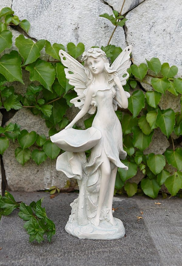 Standing Fairy Bird Feeder Statue: Bird feeders can be more dynamic. This fairy stands out on your flat garden surface, heralding the call of birds.