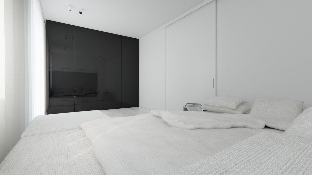 Black lacquer walling dominates in the bedroom, too. An otherwise all-white space, a grey wall challenges the black's authority. Light, dreamy chiffon and low-lying personal features create a space to relax and dream. Grey wooden flooring continues from the living room, while a leaning mirror extends the light.