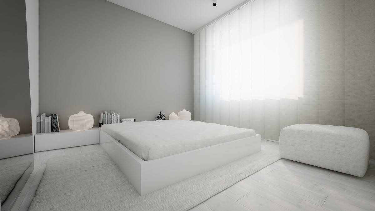 All white bedroom with personal touches white chiffon curtains white ottoman black geomtric ornament white bamboo light