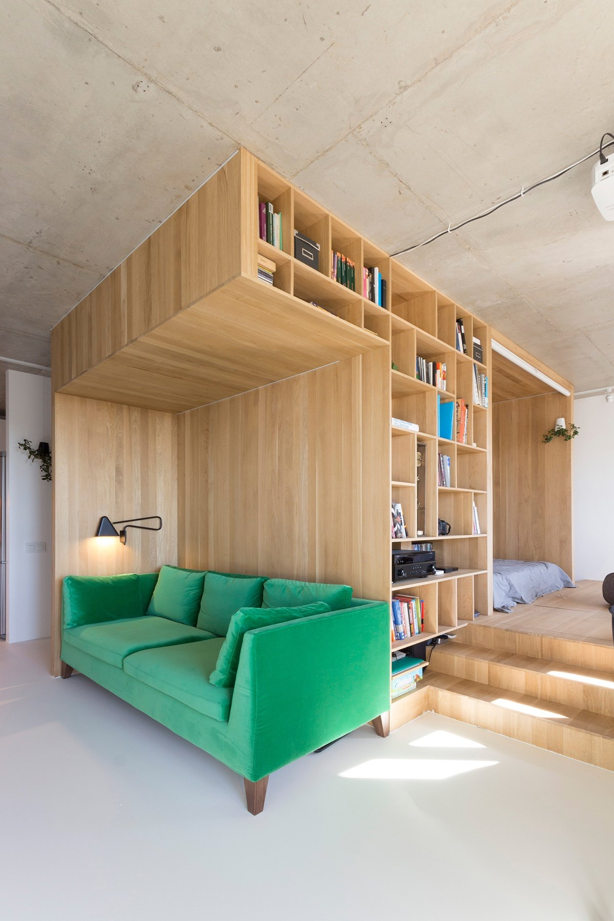 http://cdn.home-designing.com/wp-content/uploads/2016/10/Feature-leaf-green-velvet-couch-under-50sqm-living-room-backed-by-bookcase.jpg